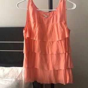 Orange ruffle sleeveless top